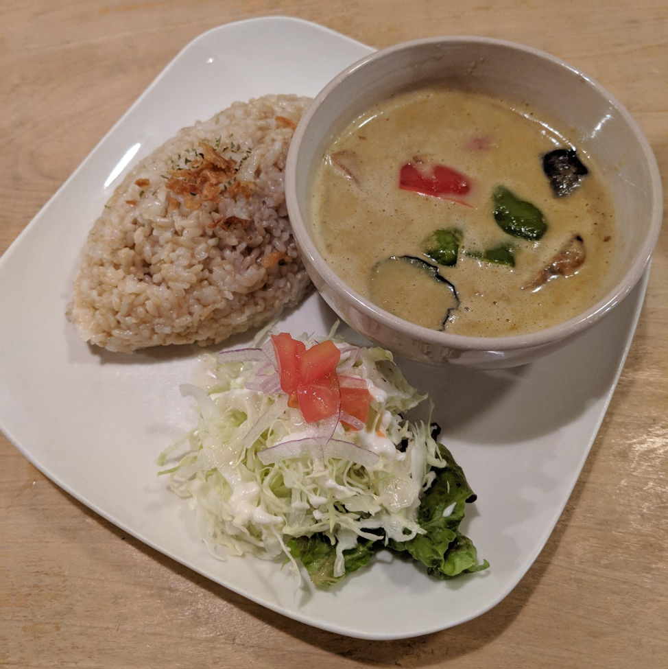 Picture of a dish comprising of a soup, vegetables and cooked rice