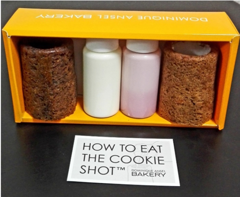 Picture of a box of Cookie Shots and an instruction booklet on how to eat them