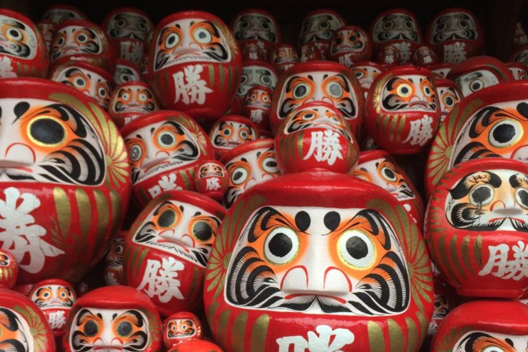 a photograph of numerous daruma dolls