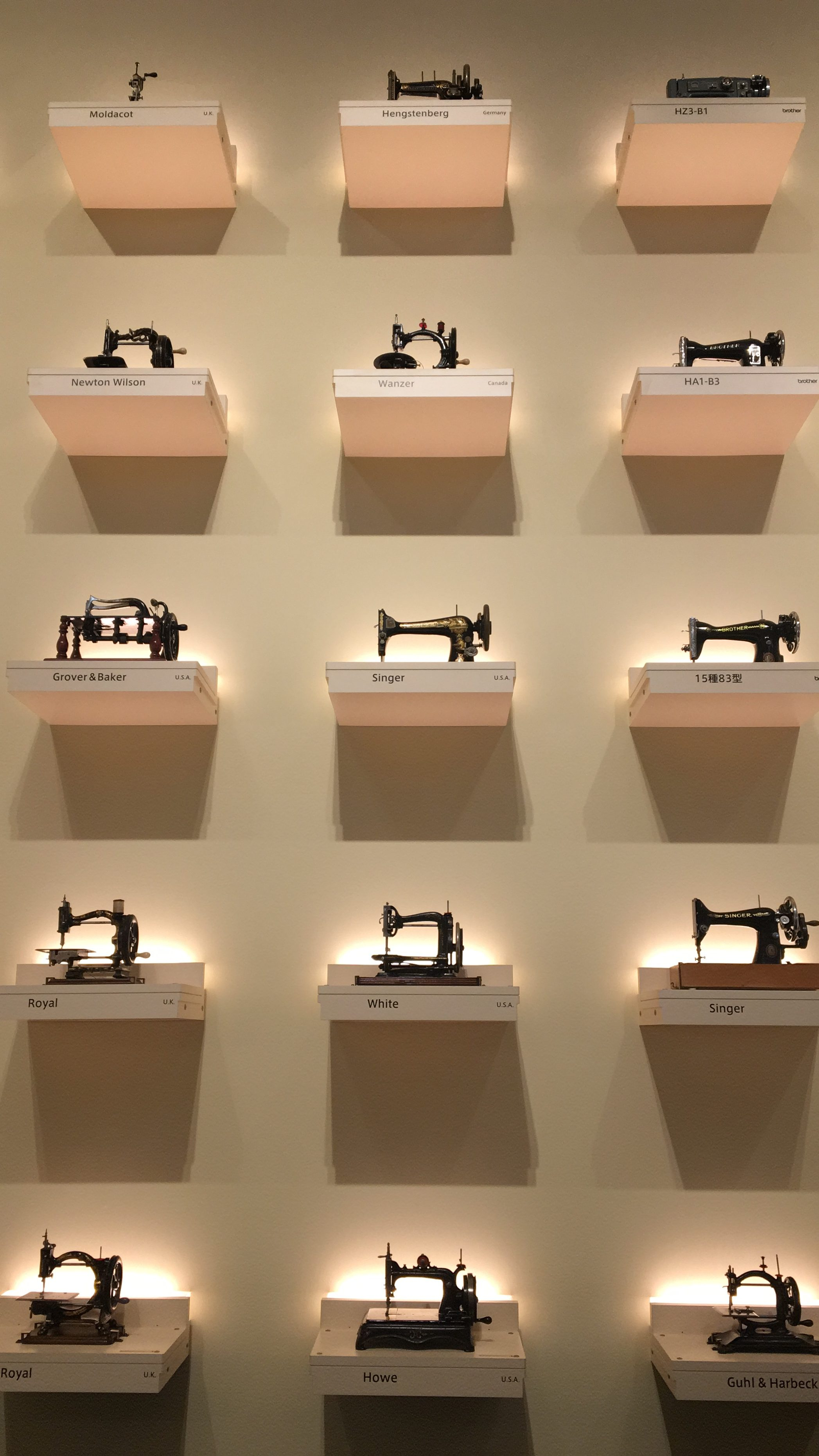 Picture of exhibits of sewing machines from around the world