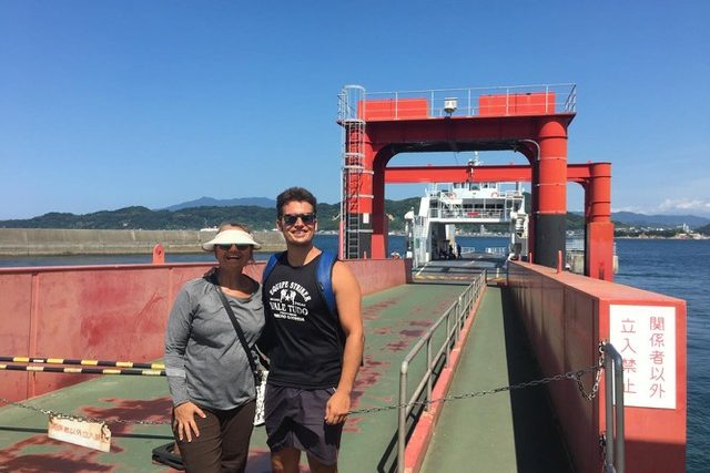 A man and a woman standing on the ferry port