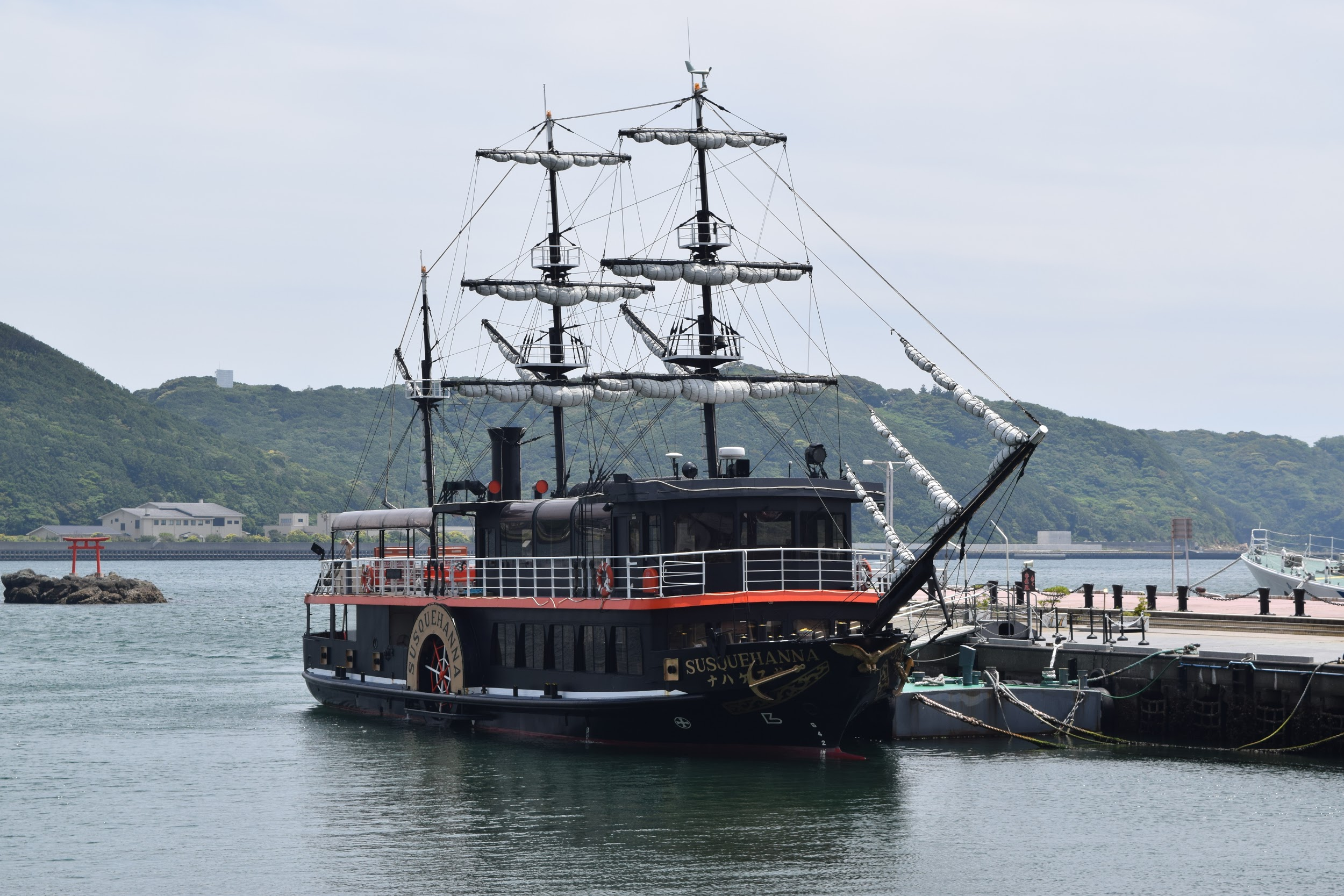 A picture of a Black Ship on the dock