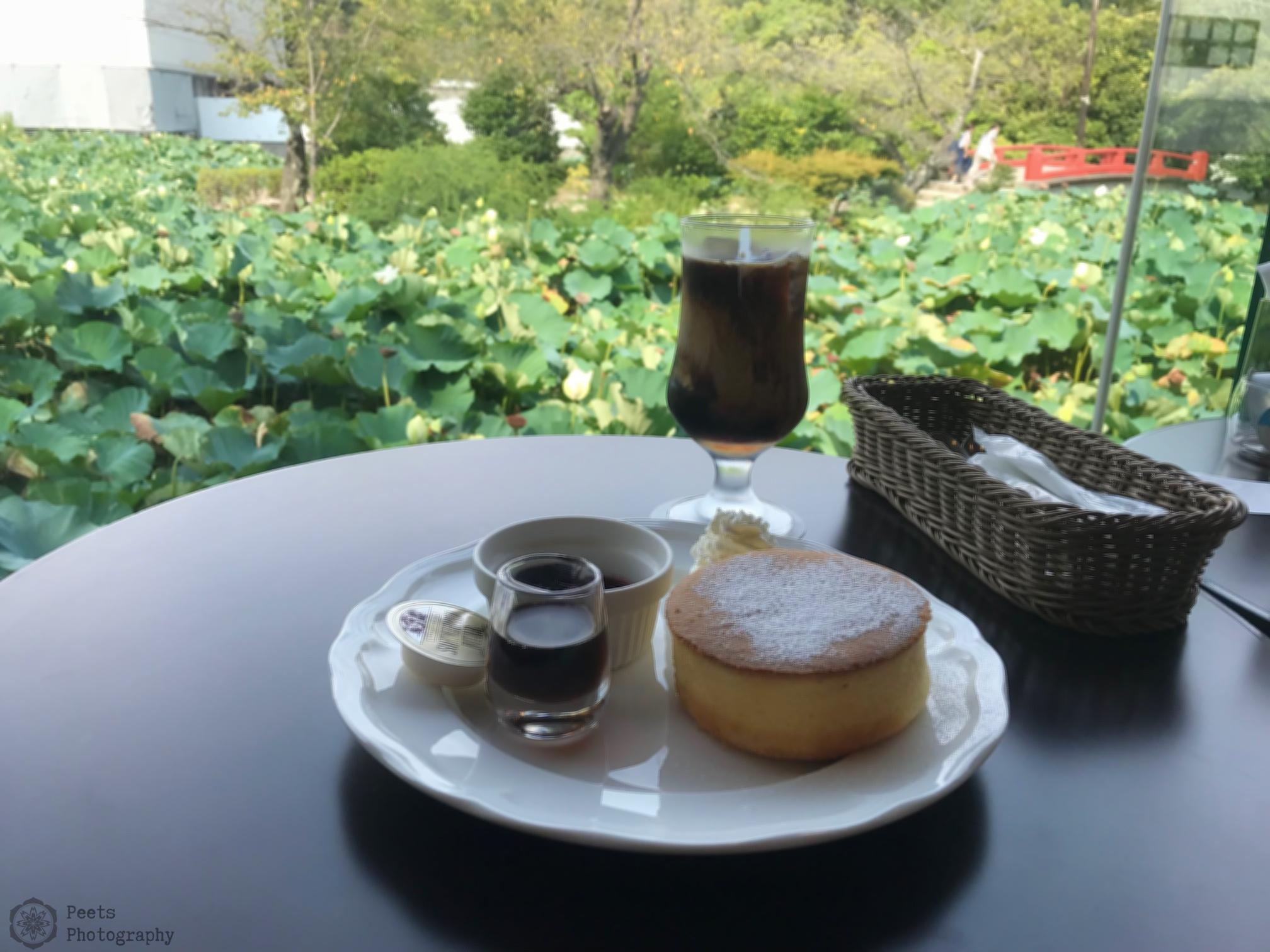 A picture of a plate with a muffin and a cup of coffee