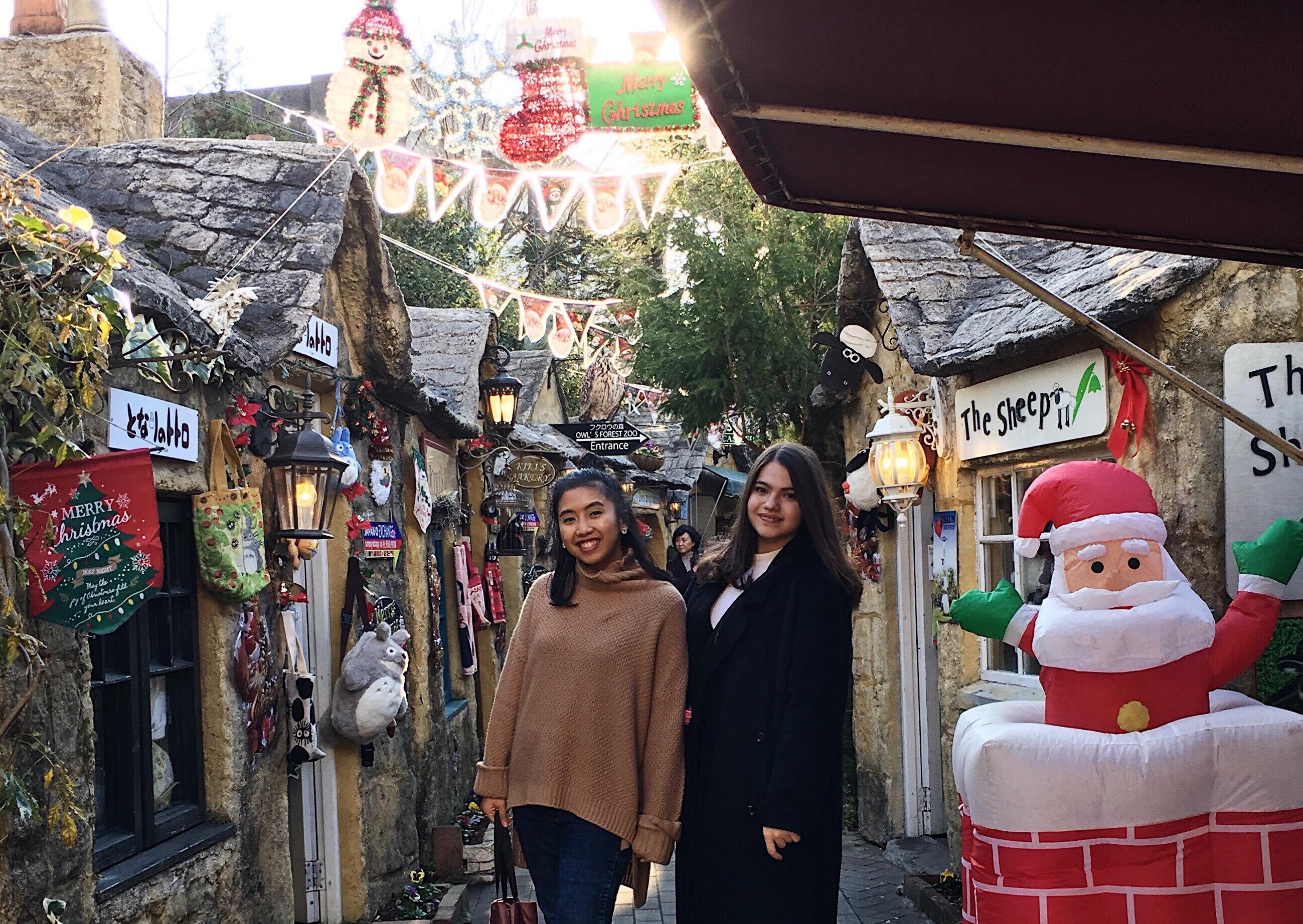 Picture of two women posing in one of the colourful streets of the Floral Village