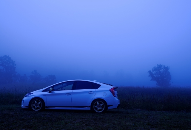 Picture of a Toyota car in the backdrop of a foggy night