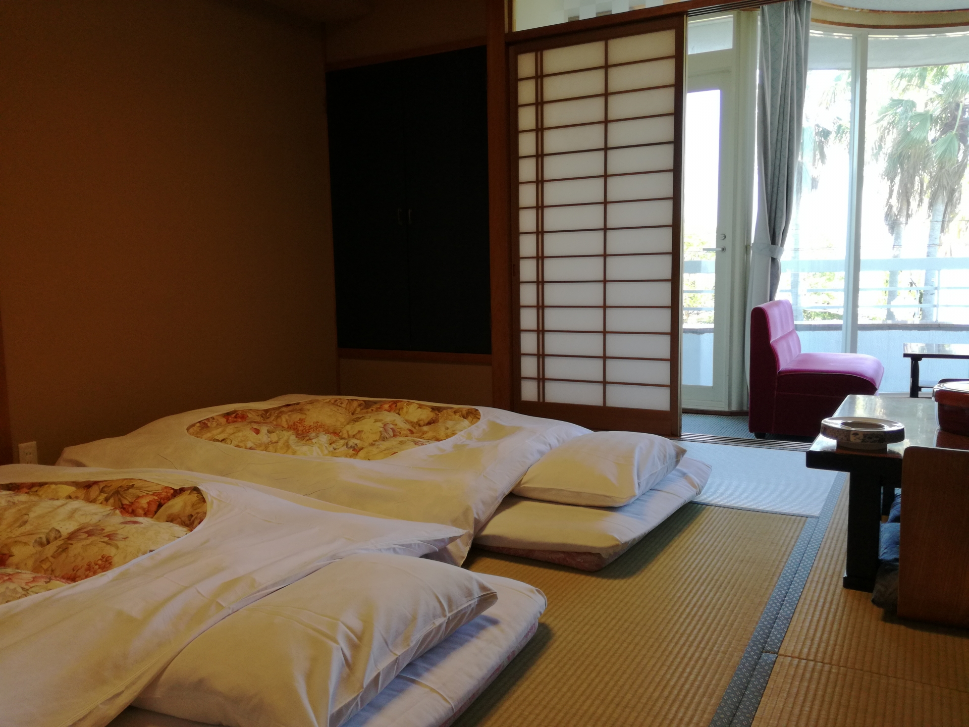 A picture of a room in a ryokan with two futon beds