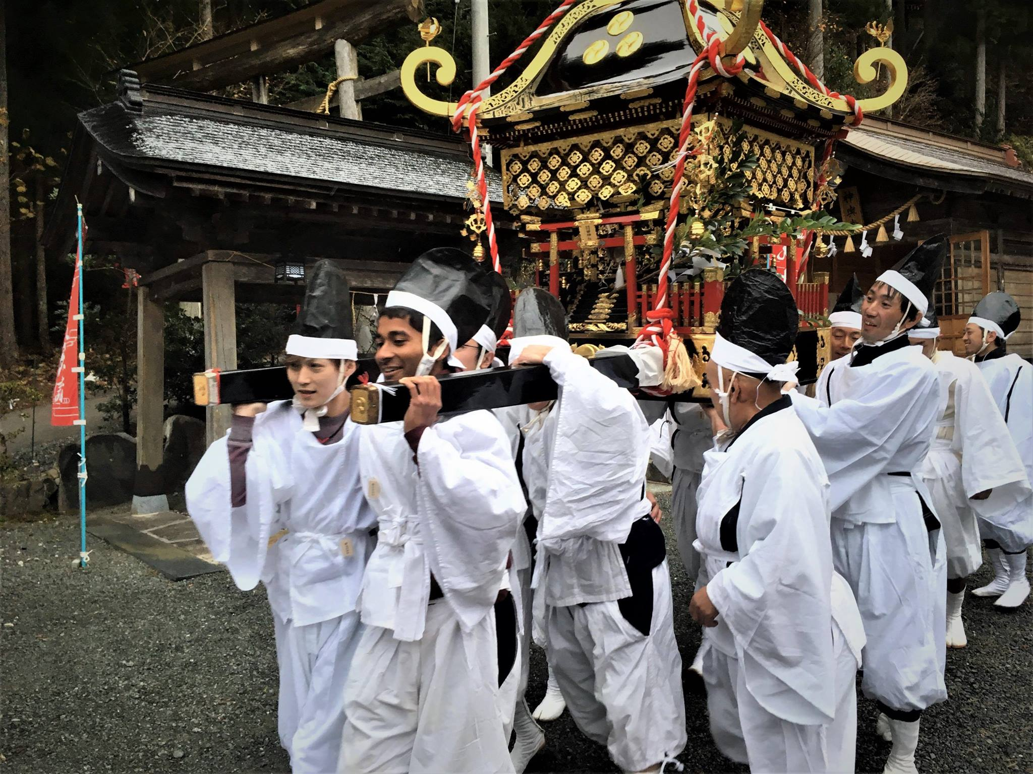 Picture of the author and other young men carrying the portable shrine
