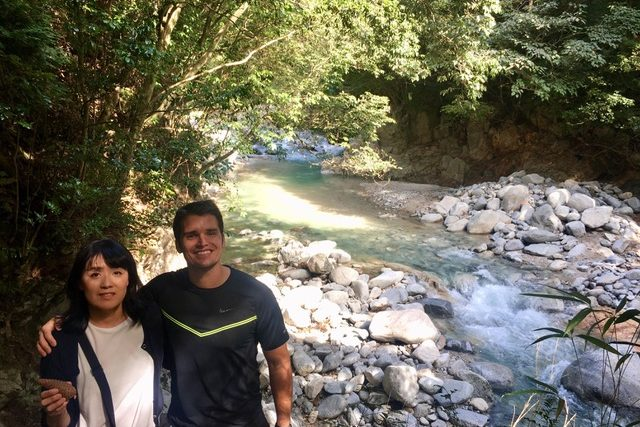 Picture of a man and a woman with the rocky stream in the background