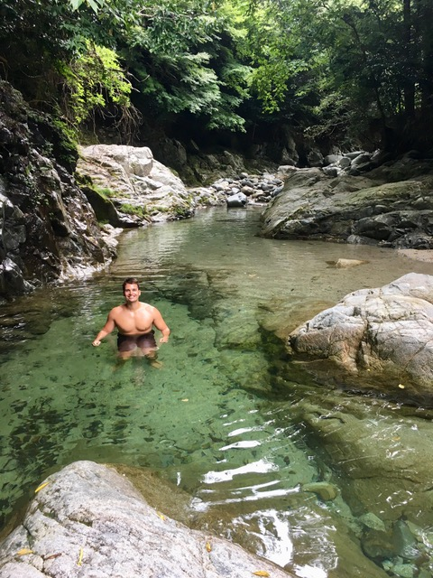 Picture of a man swimming in the river
