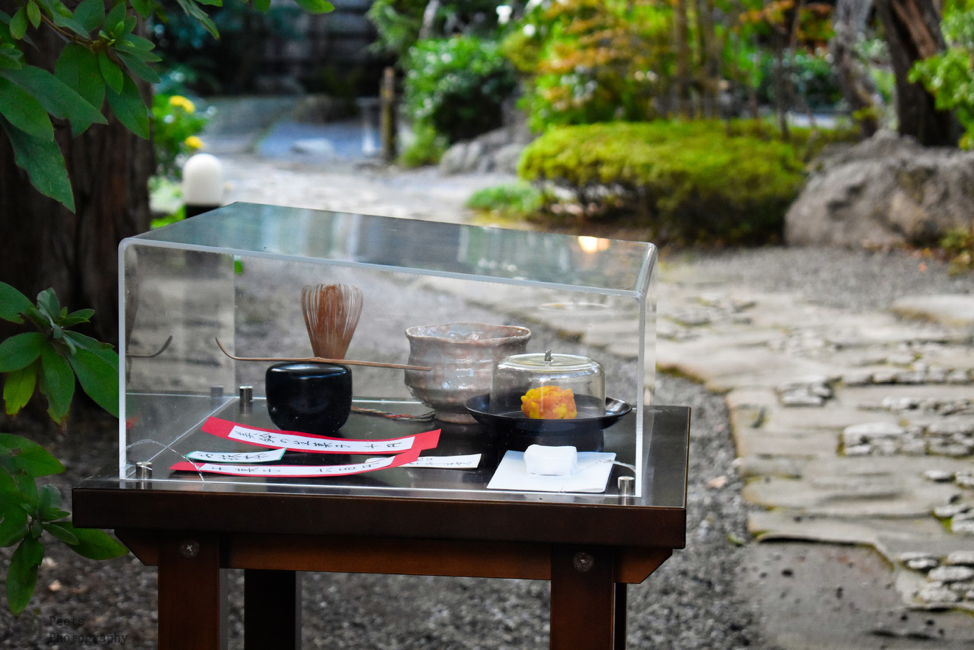 Japanese traditional sweets showcased with match green tea at a temple