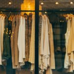 Picture of a shop window displaying clothes of muted shades