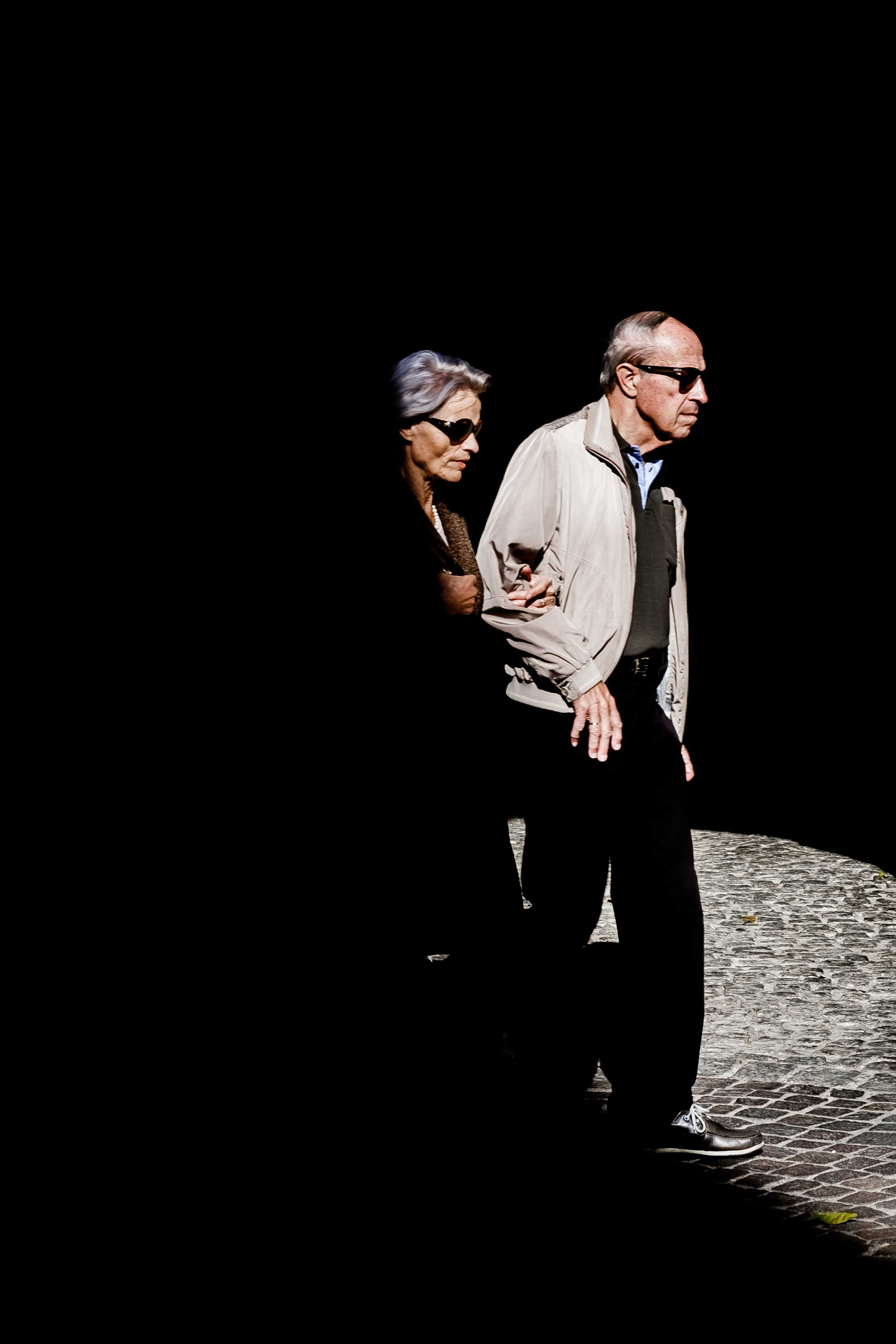 a blind woman and a blind man walking side by side